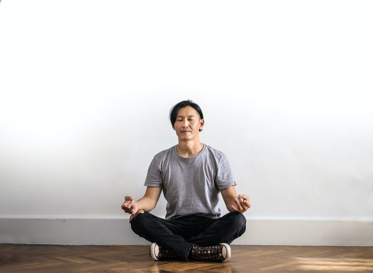 confidence man practicing mindful meditation