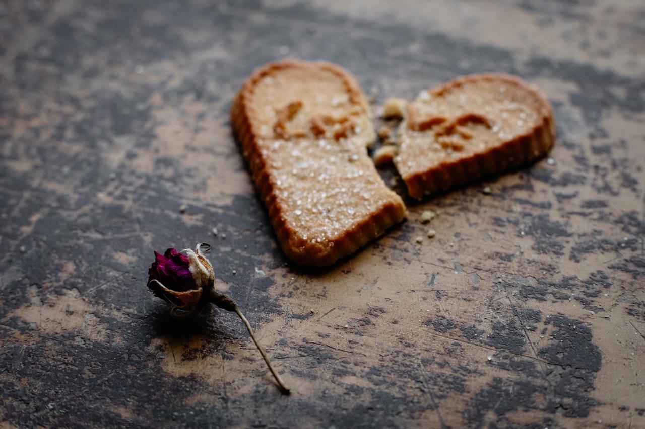 Heartache broken cookie and rose