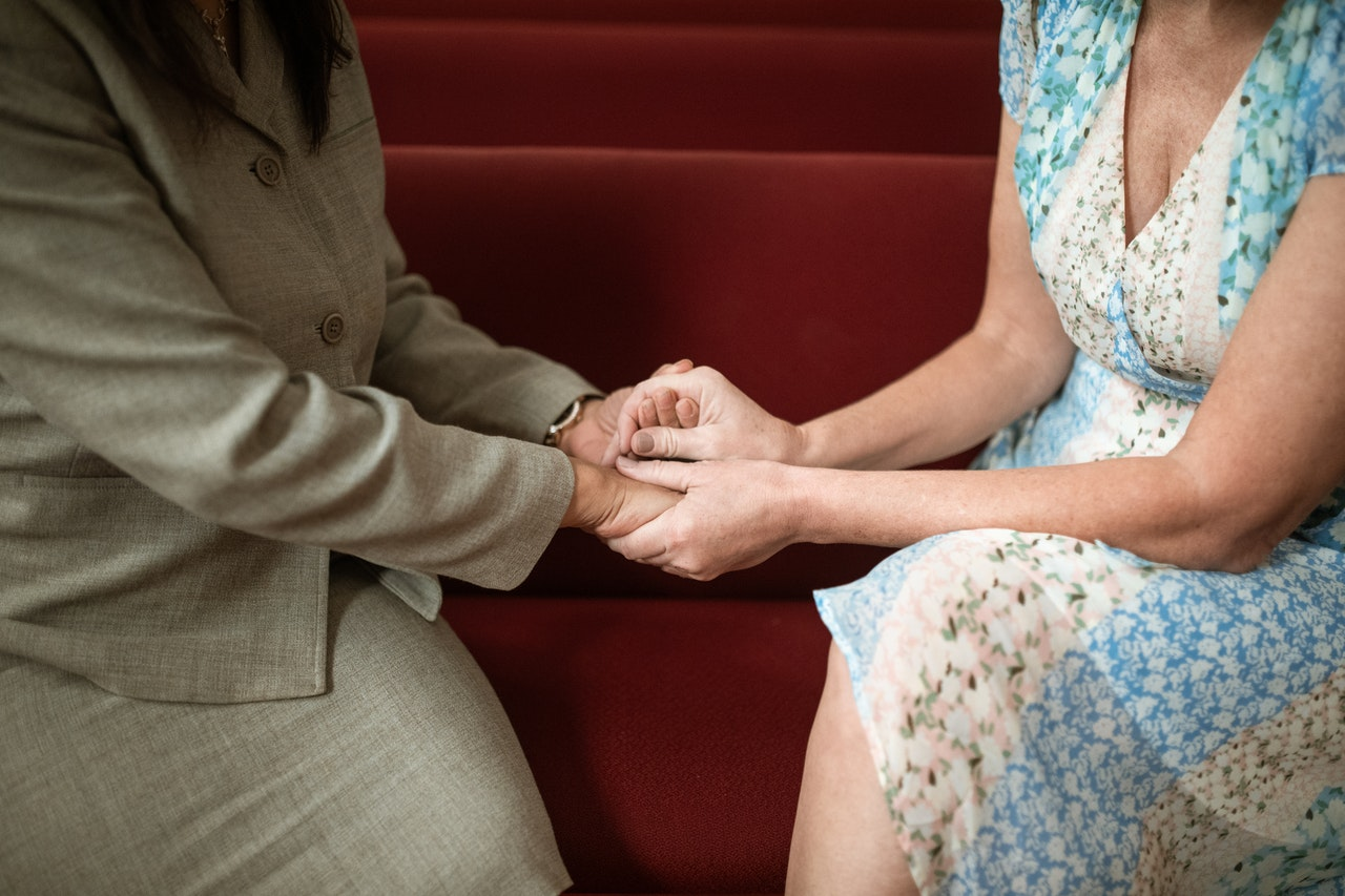 Forgiving couple holding hands