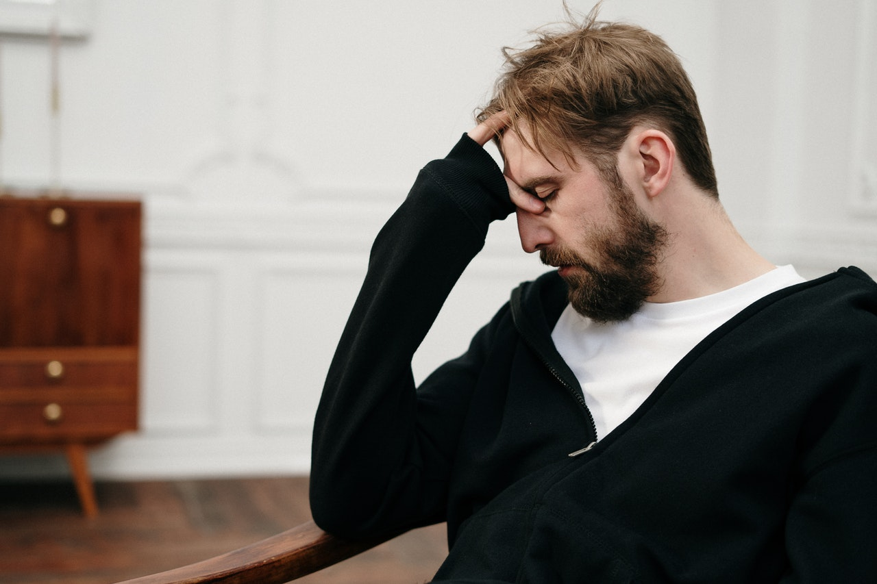 burnout man stressed out in chair
