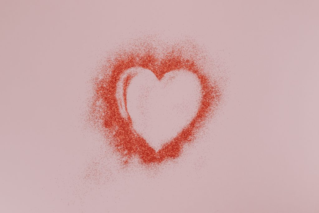 Stress in relationships heart in red ink