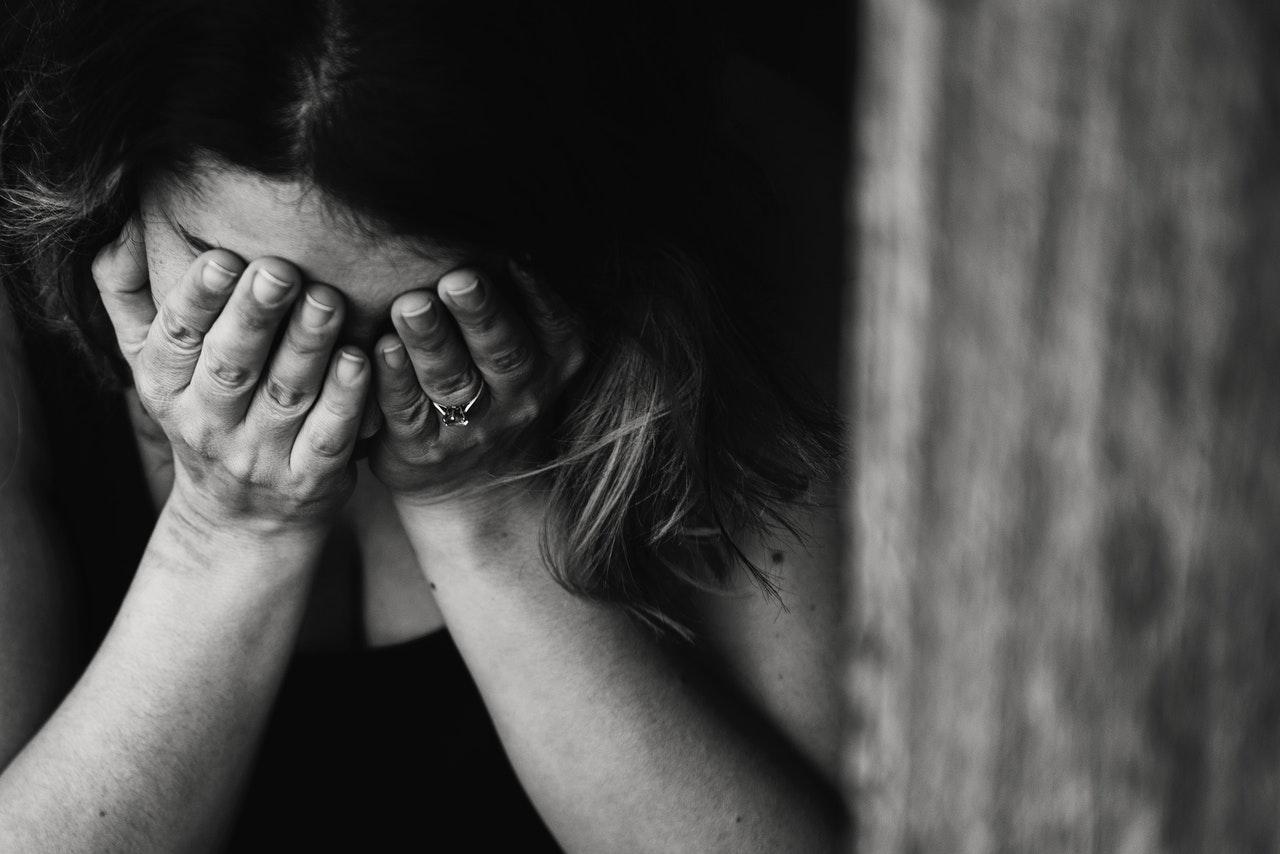 Breakup trauma woman crying alone