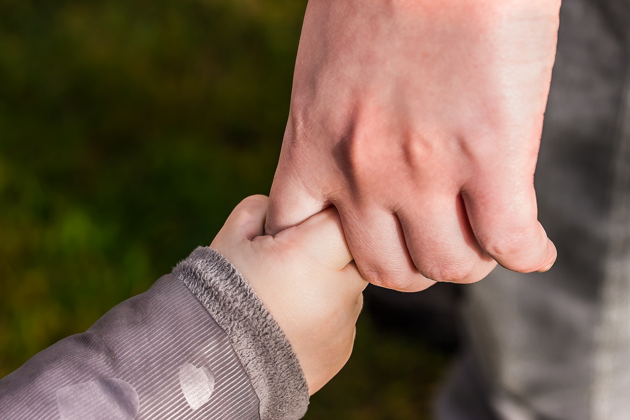 Conscious Parenting child holding parents hand