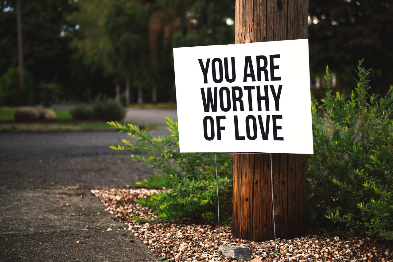 Sign on street for I have to Prove my Worth