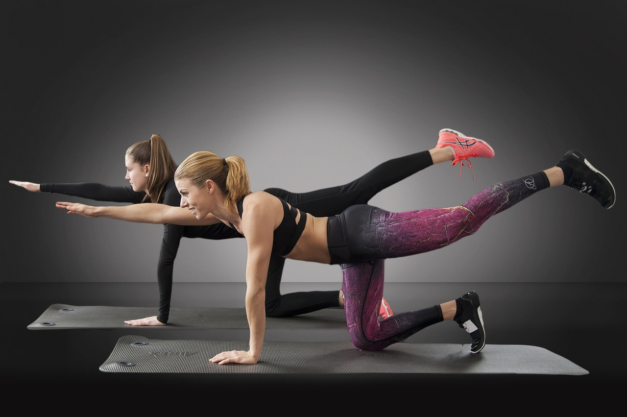 Body image issues mother and daughter working out