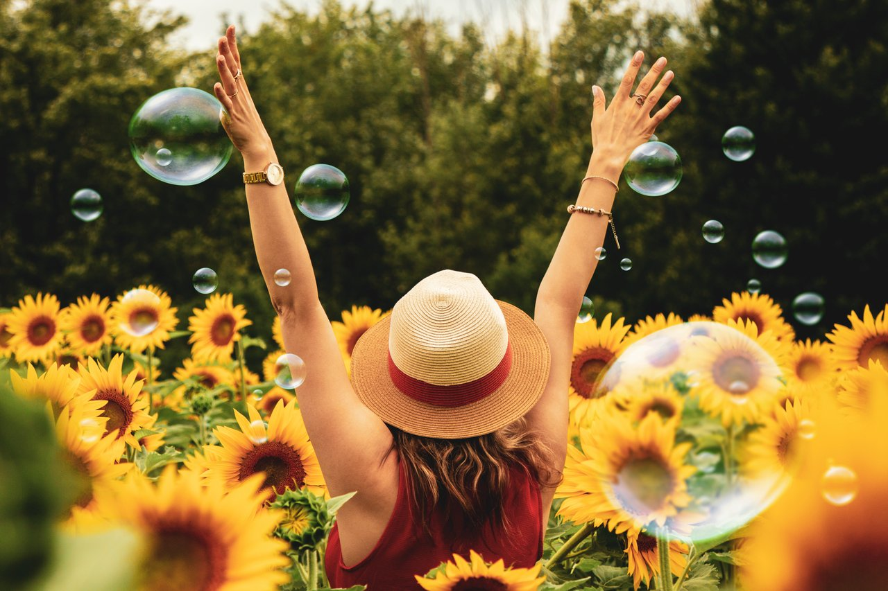 How To Be Happy woman in a flower field