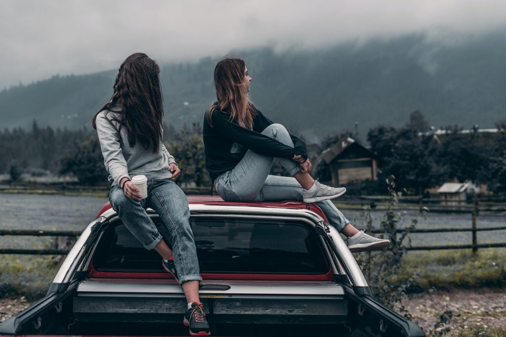 Toxic Friendship friends on top of a car