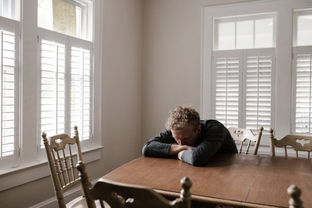 Thoughs and Feelings man sad inside his home