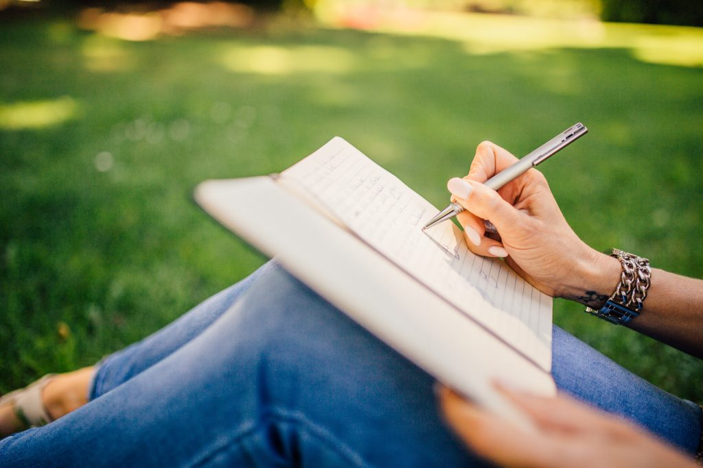 Thoughs and Feelings woman writing in journal