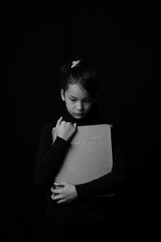 Avoidant attachment style child sad in the dark