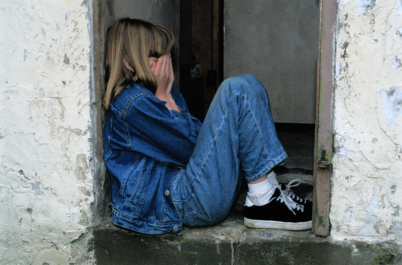 Avoidant attachment sad kid outside