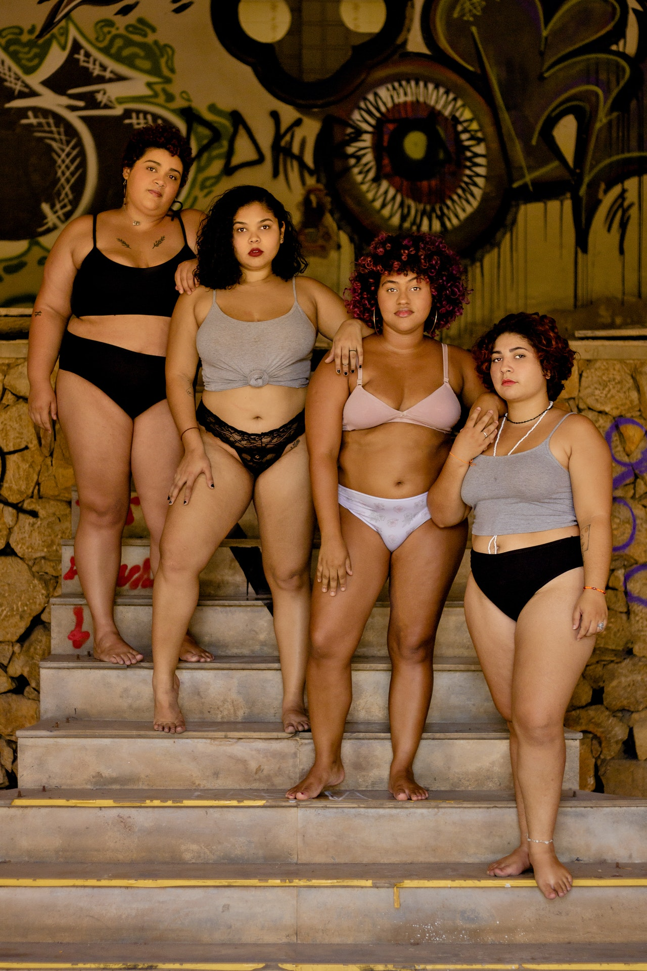 body positivity women standing on stairs