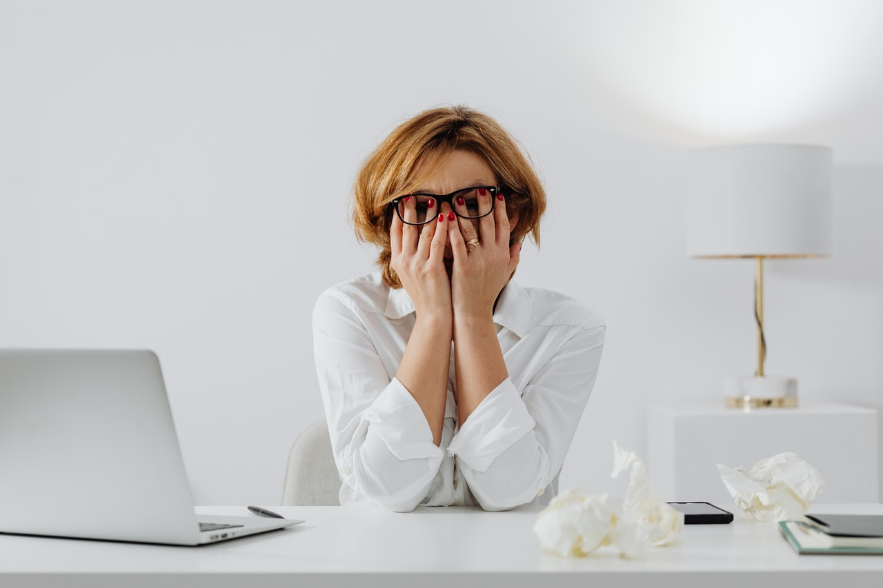 Anxiety Disorder woman holding her face