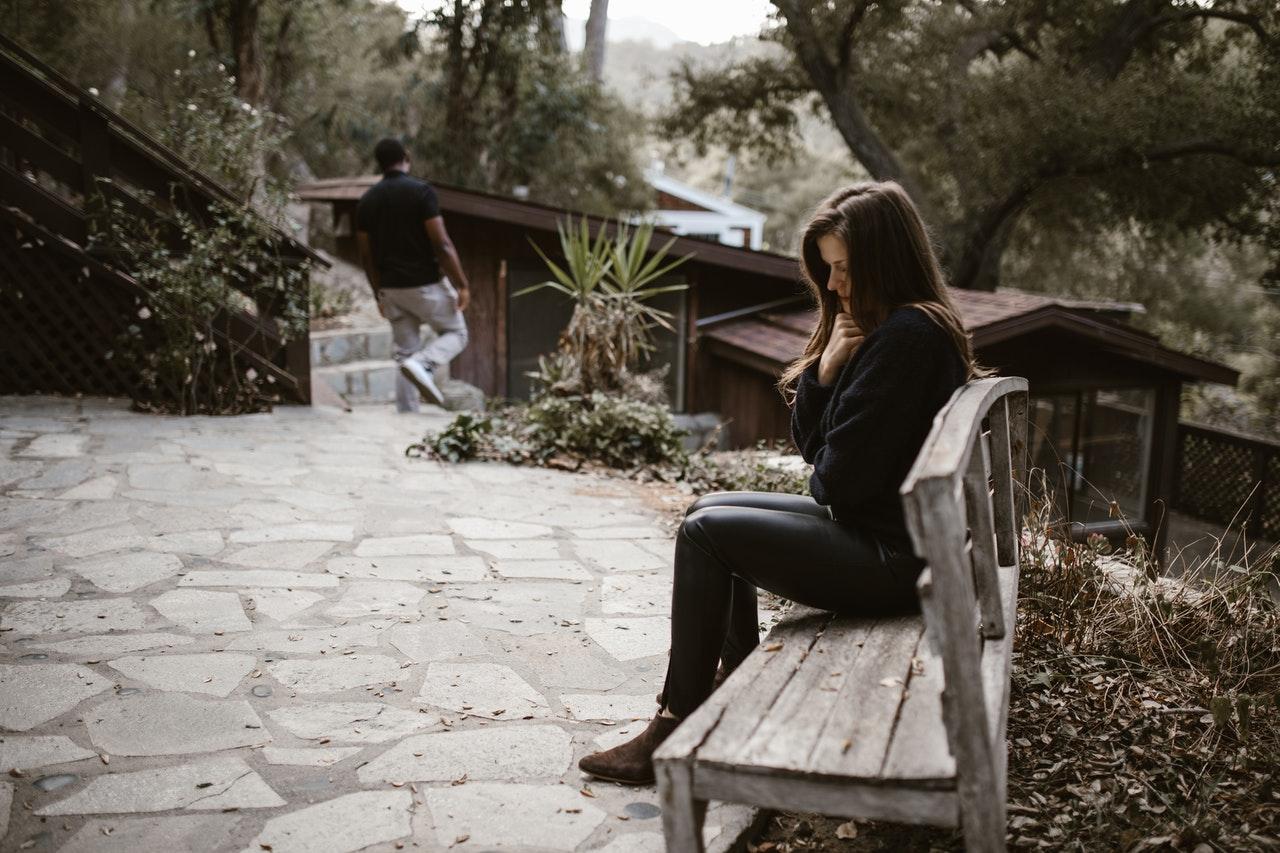 Breakups woman sitting and man walking away