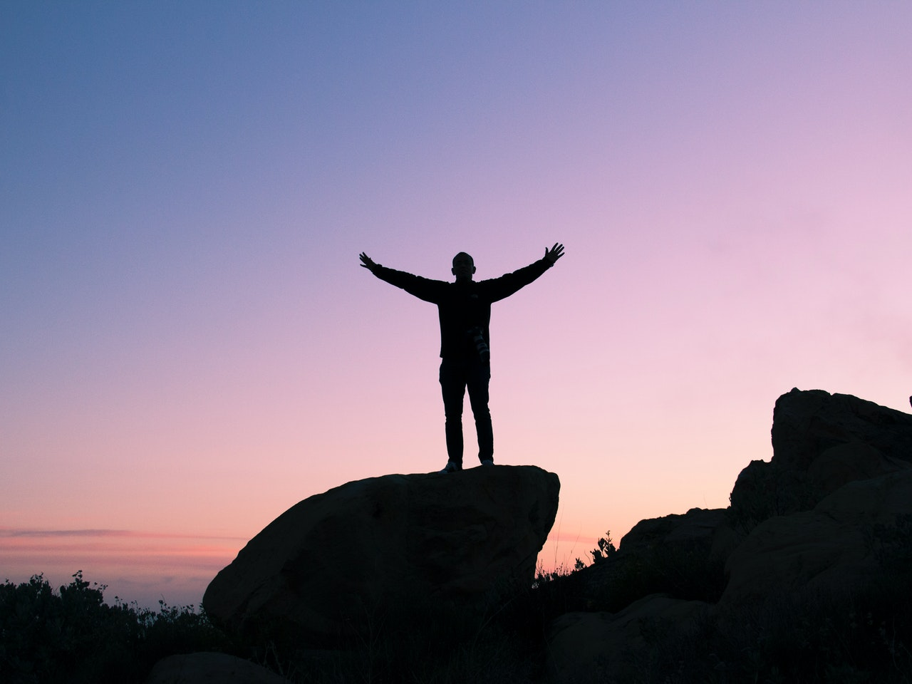 self-discovery empowering pose on rocks